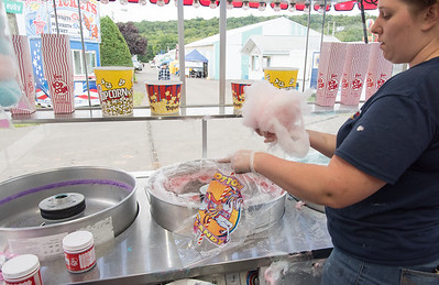 09/13/18  Wesley Bunnell | Staff  Angela Belen packages cotton candy on Thursday afternoon in anticipation of opening night at the Berlin Fair.