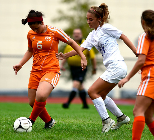 9/13/2018 Mike Orazzi | Staff Terryville's Kelly Poulin (6) and Lewis Mills' Sydney Fournier (21) during Thursday's soccer with Lewis Mills.