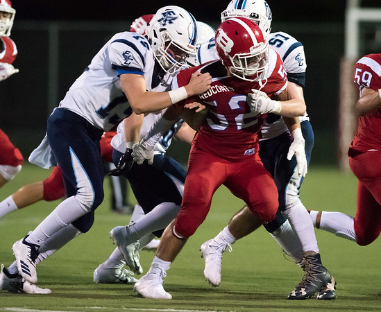 09/13/18 Wesley Bunnell | Staff Berlin football vs East Catholic at Sage Park on Thursday night. Domenic Scarano (52) is double teamed by the East Catholic defenders.