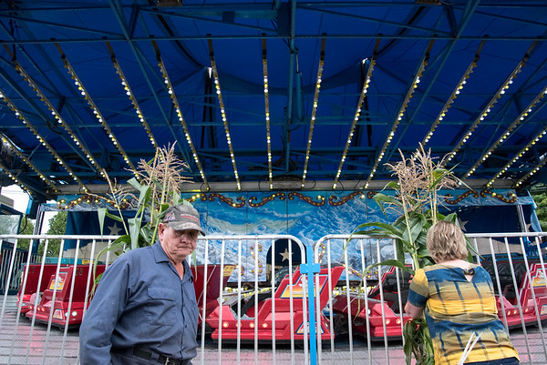 09/13/18 Wesley Bunnell | Staff Carnival workers Larry Spinney, L, and Kathy Destefano decorate rides and attractions at the Berlin Fairgrounds on Thursday afternoon.