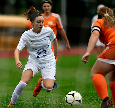 9/13/2018 Mike Orazzi | Staff Lewis Mills' Abby Mills (23) during Thursday's soccer at THS.
