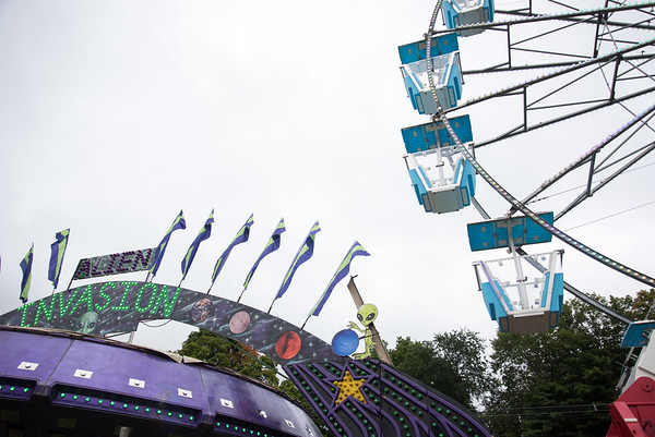09/13/18 Wesley Bunnell | Staff The Ferris Wheel and flags from an adjacent ride Alien Invasion on Thursday night prior to opening night at the Berlin Fair.