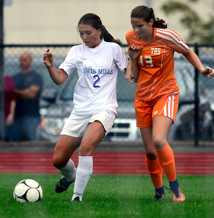 9/13/2018 Mike Orazzi | Staff Lewis Mills' Brianna Pelchar (2) and Terryville's Madison Maske (13) during Thursday's soccer at THS