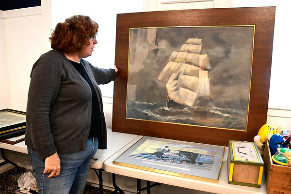 9/13/2018 Mike Orazzi | Staff Maya Bringe, co-chair of the Bristol Historical Society Auction, with some of the items for sale this Saturday.