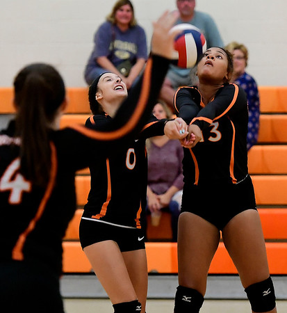 9/13/2018 Mike Orazzi | Staff Terryville's Cara Andrews (0) and Kristine Gutierrez (13) during Thursday's match at Terryville High School.