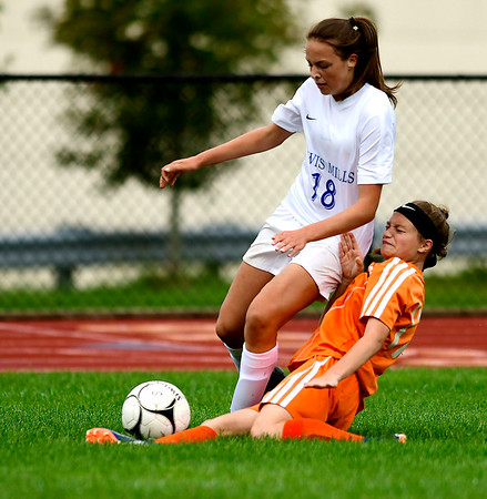 9/13/2018 Mike Orazzi | Staff Lewis Mills' Kaitlyn Ouellette (18) and Terryville's Alivia Cote (17) during Thursday's soccer at THS.