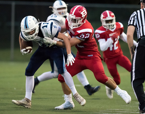 09/13/18 Wesley Bunnell | Staff Berlin football vs East Catholic at Sage Park on Thursday night. Domenic Scarano (52) on the tackle of the East Catholic quarterback.
