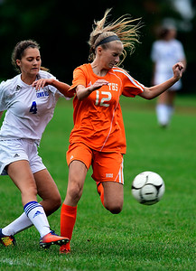 9/13/2018 Mike Orazzi | Staff Lewis Mills' Kayah Lutrzykowski (4) and Terryville's Reilly Stager (12) during Thursday's soccer at THS