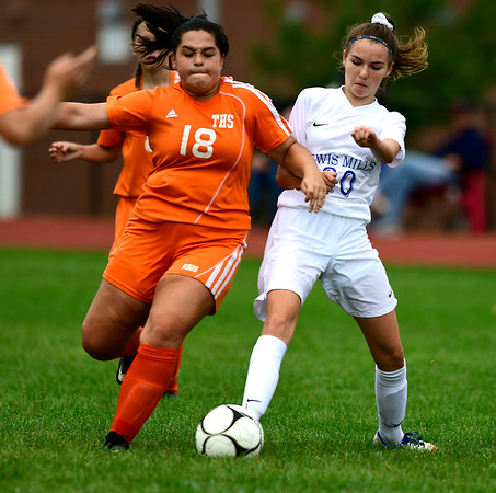9/13/2018 Mike Orazzi | Staff Lewis Mills' Julia Malejczyk (20) and Terryville's Brynn Hudson (18) during Thursday's soccer at THS.