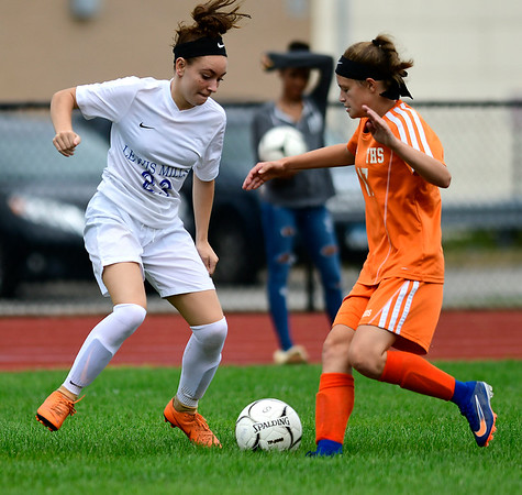 9/13/2018 Mike Orazzi | Staff Lewis Mills' Abby Mills (23) and Terryville's Alivia Cote (17) during Thursday's soccer at THS.