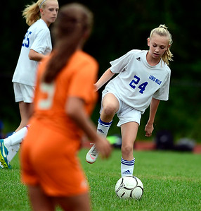 9/13/2018 Mike Orazzi | Staff Lewis Mills' Amy Crossman (24) during Thursday's soccer at THS.