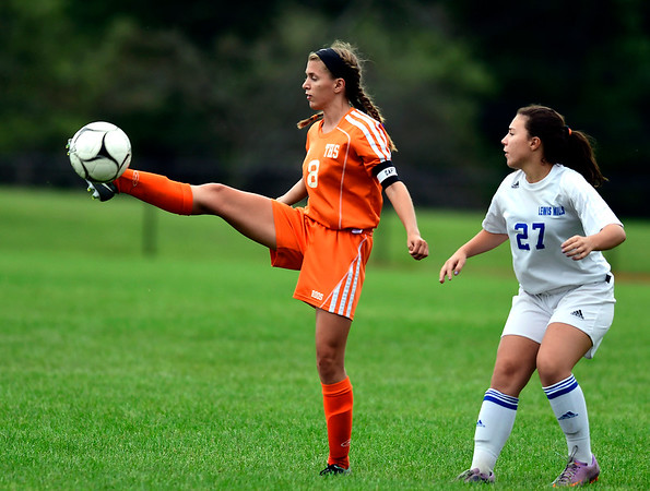 9/13/2018 Mike Orazzi | Staff Lewis Mills' Hannah Anderson (27) and Terryville's Linsdey Hotchkiss (8) during Thursday's soccer at THS.