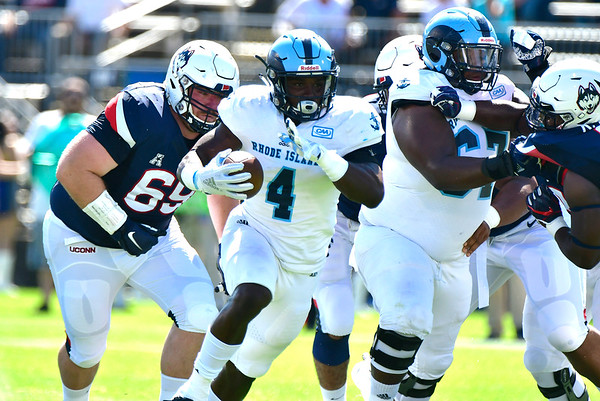9/15/2018 Mike Orazzi   Staff UConn's Ryan Fines (69) and University of Rhode Island's Zoe Bryant, Jr. (4) in East Hartford Saturday.