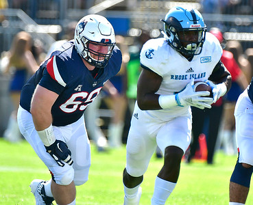 9/15/2018 Mike Orazzi | Staff UConn's Ryan Fines (69) and University of Rhode Island's Zoe Bryant, Jr. (4)  in East Hartford Saturday.