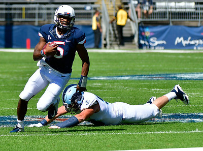 9/15/2018 Mike Orazzi | Staff UConn's David Pindell (5) and University of Rhode Island's Brandon Ginnetti (99) in East Hartford Saturday.