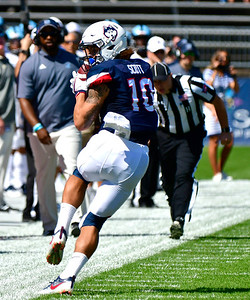 9/15/2018 Mike Orazzi | Staff UConn's Zavier Scott (10) during Saturday's win over the University of Rhode Island in East Hartford.
