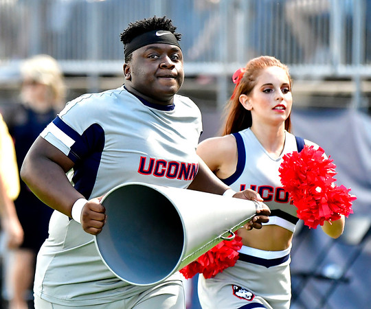 9/15/2018 Mike Orazzi   Staff UConn cheerleaders during Saturday's win over the University of Rhode Island in East Hartford.