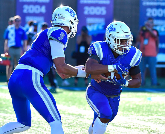9/15/2018 Mike Orazzi   Staff CCSU's Jacob Dolegala (9) and Drew Jean-Guillaume (20) during Saturdays' football game with in New Britain.
