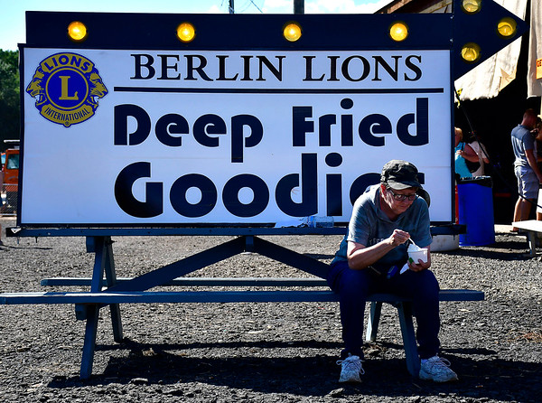 9/15/2018 Mike Orazzi   Staff Mary Dube eats an ice cream sundae during the 70th annual Berlin Fair on Saturday.