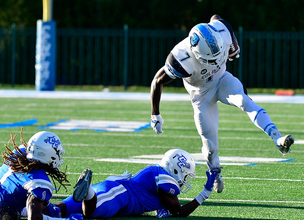 9/15/2018 Mike Orazzi   Staff Columbia's Dante Miller (7)) and CCSU's DJ Exilhomme (1) and Grant Ibeh (8) during Saturdays' football game in New Britain.