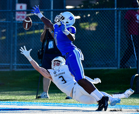 9/15/2018 Mike Orazzi   Staff Columbia's Kyle Castner (3) and CCSU's Grant Ibeh (8) during Saturdays' football game in New Britain.