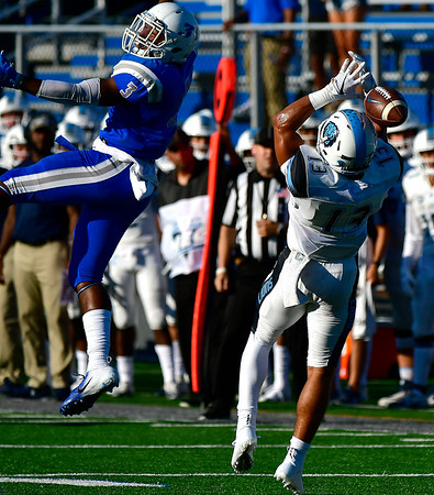 9/15/2018 Mike Orazzi   Staff Columbia's Josh Wainwright (13) and CCSU's Antwann Anderson (3) during Saturdays' football game in New Britain.