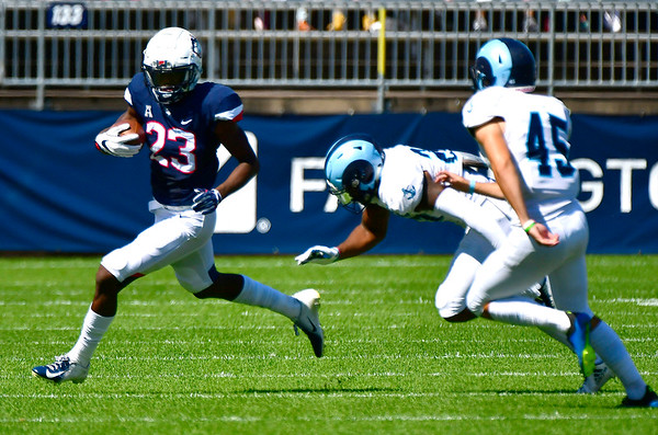 9/15/2018 Mike Orazzi   Staff UConn's Keyion Dixon (23) during Saturday's win over the University of Rhode Island in East Hartford.