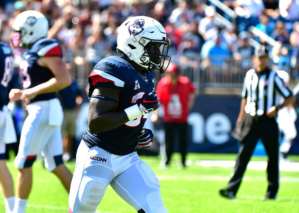 9/15/2018 Mike Orazzi   Staff UConn's Kevin Mensah (34) during Saturday's win over the University of Rhode Island in East Hartford.