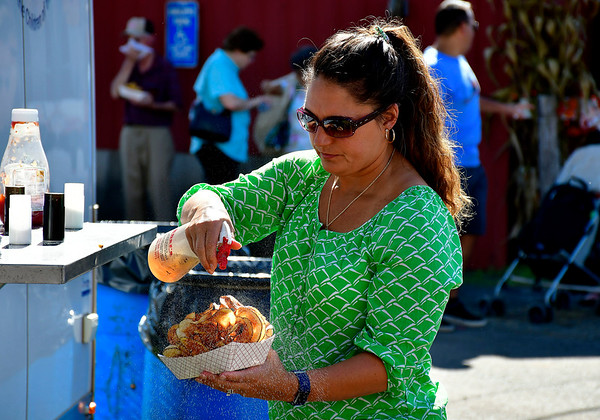 9/15/2018 Mike Orazzi   Staff Sherri Martin prepares to eat some potato chips during the 70th annual Berlin Fair on Saturday.