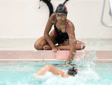 09/18/18  Wesley Bunnell | Staff  Berlin girls swimming defeated Maloney High School 92-83 on Tuesday afternoon at Maloney High School. Najey Ramos holds a lap board underwater for teammate Gabriella Patavina in the 500 free in which she would take first place.