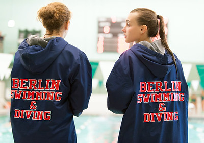 09/18/18  Wesley Bunnell | Staff  Berlin girls swimming defeated Maloney High School 92-83 on Tuesday afternoon at Maloney High School.  Diver Abbie Rochette, R, talks with a teammate between races.