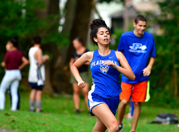 9/19/2018 Mike Orazzi | Staff Plainville's Emma Lopez during Wednesday's girls cross country meet between Bristol Central, Platt and Plainville at Rockwell Park in Bristol on Wednesday.
