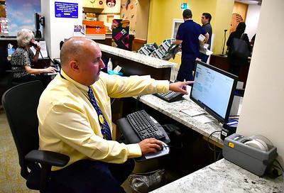 9/19/2018 Mike Orazzi | Staff Bristol Hospital's Darius Erami visitor's badge system Wednesday.