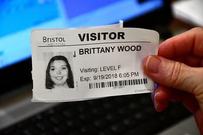 9/19/2018 Mike Orazzi | Staff Bristol Hospital's Diane Desjardins prints a visitor's badge Wednesday.