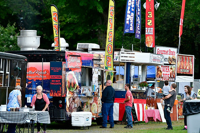 9/20/2018 Mike Orazzi | Staff Food vendors during this year's mum festival on Memorial Blvd. Thursday evening.