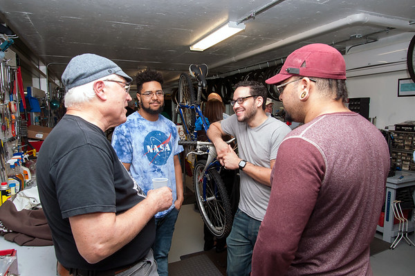 09/25/18 Wesley Bunnell | Staff Bike New Britain held a ribbon cutting at its 39 Bank St location on Tuesday afternoon. Volunteers Mark Hoffman, L, Joshua Wrice, Onil Vazquez and Sabriel Vazquez talk as they stand in the middle to the bicycle repair stations and tools.