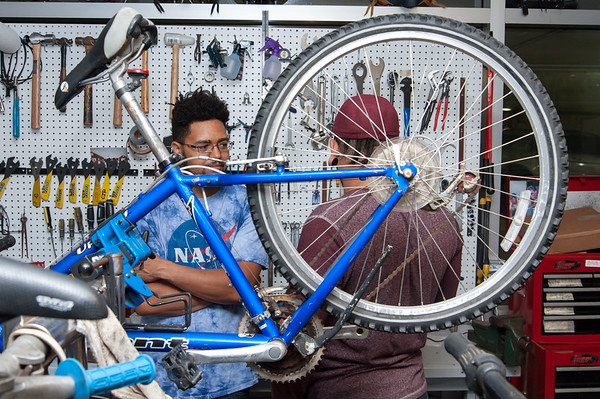 09/25/18 Wesley Bunnell | Staff Bike New Britain held a ribbon cutting at its 39 Bank St location on Tuesday afternoon. Volunteer Joshua Wrice, L, speaks with fellow volunteer Sabriel Vazquez.