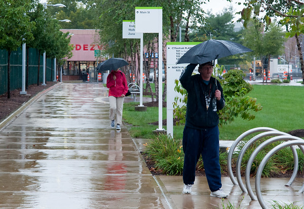 09/25/18 Wesley Bunnell | Staff Michael Williams, R, walks towards the CT Fastrak Station in downtown New Britain on a rainy Tuesday afternoon.