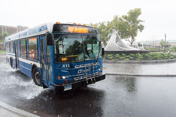 09/25/18 Wesley Bunnell | Staff A CT Transit Bus makes its way down Columbus St in heavy rain on Tuesday afternoon.