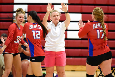 09/26/18  Wesley Bunnell | Staff  Berlin volleyball defeated Plainville on Wednesday night at Berlin High School.  Berlin Coach Angela Kumm high gives players including Rachael Meade (17).