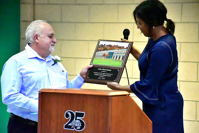 9/25/2018 Mike Orazzi | Staff Retiring head custodian John Mastroianni receives a plaque from principal Mariliz Fitzpatrick during the 25th Anniversary Celebration at the Chippens Hill Middle School Tuesday evening.