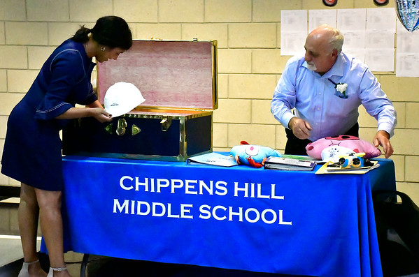 9/25/2018 Mike Orazzi | Staff Retiring head custodian John Mastroianni (right) and principal Mariliz Fitzpatrick open a time capsule during the 25th Anniversary Celebration at the Chippens Hill Middle School Tuesday evening.