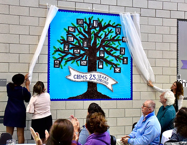 9/25/2018 Mike Orazzi | Staff The unveiling of the 25th Anniversary Bulletin Board at the Chippens Hill Middle School Tuesday evening.