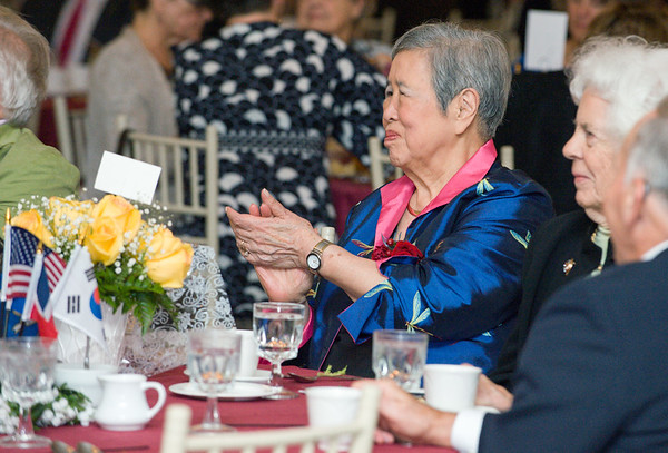 09/27/18 Wesley Bunnell   Staff The Immigrant Heritage Hall of Fame 2018 Gala and Induction Ceremonies was held on Thursday night at The Aqua Turf Club. Dr. Hesung Chun Koh, applauds as her son Prof Harold Hongju Koh gives a speech regarding his father inductee Dr. Kwang Lim Koh who was inducted posthumously.