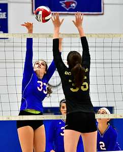 9/27/2018 Mike Orazzi | Staff St. Paul Volleyball's Kelsi Blatchley (33) and Woodland's Fatima Khalid (29) Thursday night in Bristol.