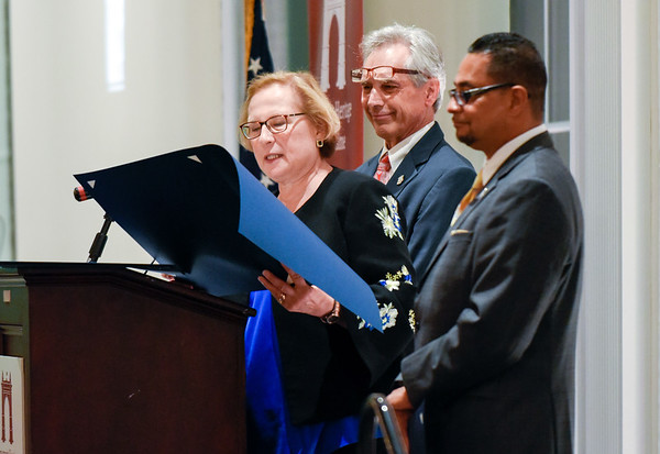 09/27/18 Wesley Bunnell   Staff The Immigrant Heritage Hall of Fame 2018 Gala and Induction Ceremonies was held on Thursday night at The Aqua Turf Club. State Senator Terry Gerratana reads proclamations from the State of CT as Rep. Peter Tercyak, middle, and Rep Geraldo Reyes Jr look on.