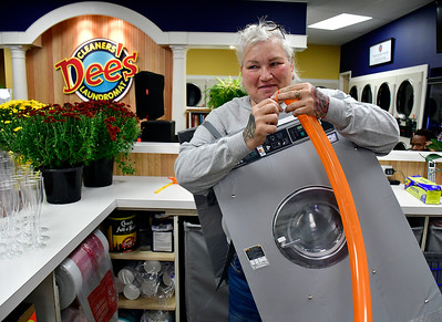 9/28/2018 Mike Orazzi | Staff Sandy Leal during grand opening ceremony at Dee's Cleaners & Laundromat at 900 Farmington Avenue in Bristol Friday afternoon.