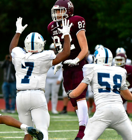 9/28/2018 Mike Orazzi | Staff Bristol Central High School's Ryan Rodriguez (82) and Middletown's Xzavier Reyes (7) and Brady Foster (58) during Friday night's football game at BC.