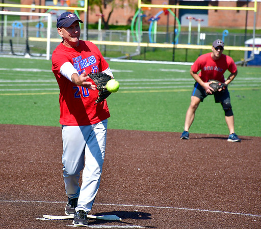 9/29/2018 Mike Orazzi   Staff New Britain firefighter Chris Wallis during the annual charity softball game between the New Britain fire and police departments at Chesley Park. This year, the fire department decided to raise money for New Britain-based Connecticut Breast Health Initiative, an organization that raises money and distributes it to breast cancer-related research and education in the state. CT BHI was picked this year in honor of New Britain Police Department Lt. Julia Gallup, who was diagnosed with breast cancer earlier this year and has been fighting the disease since.