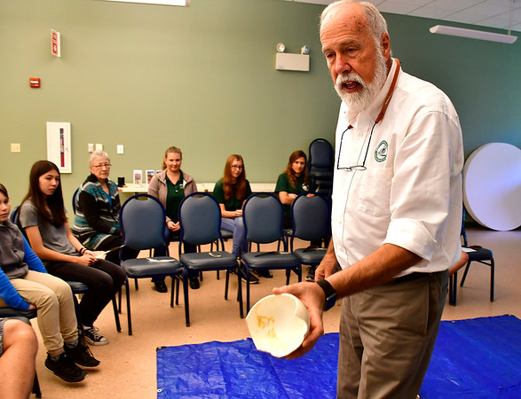 9/29/2018 Mike Orazzi   Staff Livingston Ripley Waterfowl Conservancy's Jay Fields shows off an ostrich egg during a presentation on birds at the Indian Rock Nature Center in Bristol Saturday morning.
